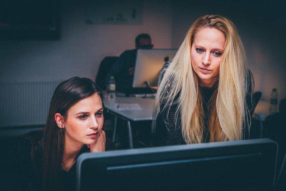 Two female investigators at computer